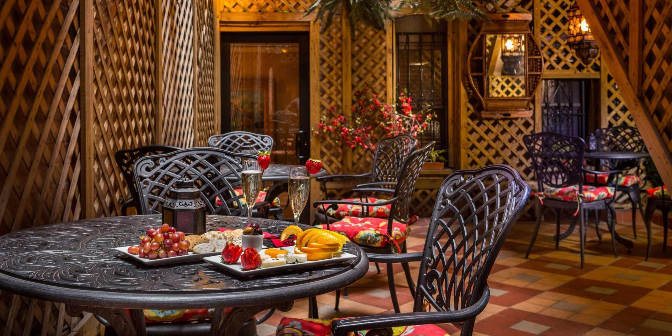 When the weather is warm, guests can enjoy wine and cheese in our Blue Parrot Courtyard.