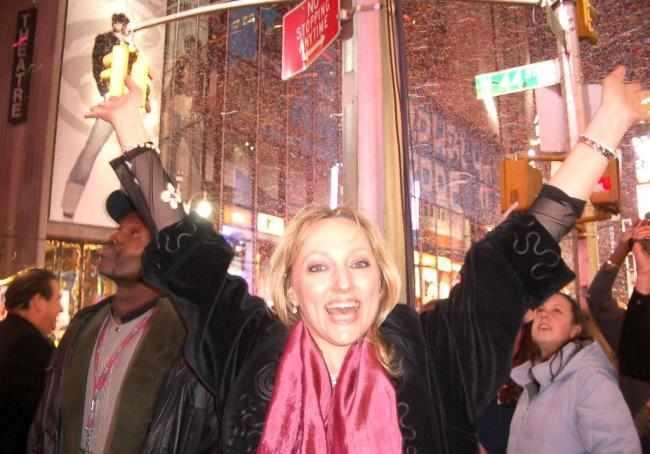 Woman celebrating the New Year on the streets of Times Square