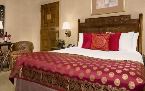 Our Deluxe Rooms with 1 Queen Sized bed have approximately 250 square feet total space.