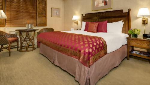 Premium Rooms with 1 King bed are approximately 275 square feet with a very spacious mattress that is approximately 76 inches wide by 80 inches long.