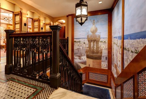 Feel the Moroccan flair with a picturesque mural as you walk up the steps to Rick's Cafe.