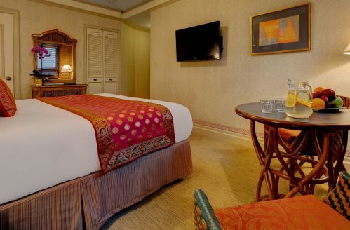 Premium Rooms with 1 King bed are approximately 275 square feet with a bistro table.